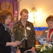 Soroptimist members from nearby clubs: Marlyn, Joanne & Sue check out the upcoming Chocolate Affair fundraiser flyer