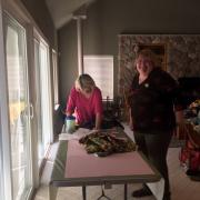 SI Placerville's Judy & Sharon prepping dresses