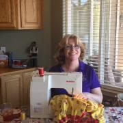 SI Placerville's President Tanya sewing a new dress!
